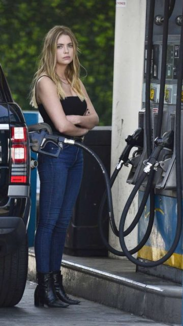 Ashley Benson in Black Top and Jeans at a gas station in Hollywood