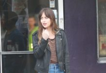 "Dakota Johnson in Leather Jacket and Jeans – ""Covers"" Set in Los Angeles"
