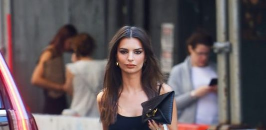 Emily Ratajkowski in a Catsuit With Snakeskin Boots