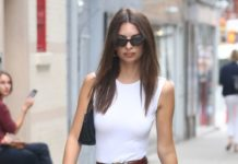 Emily Ratajkowski in White Tank, Jeans and Yellow Knee-High Boots