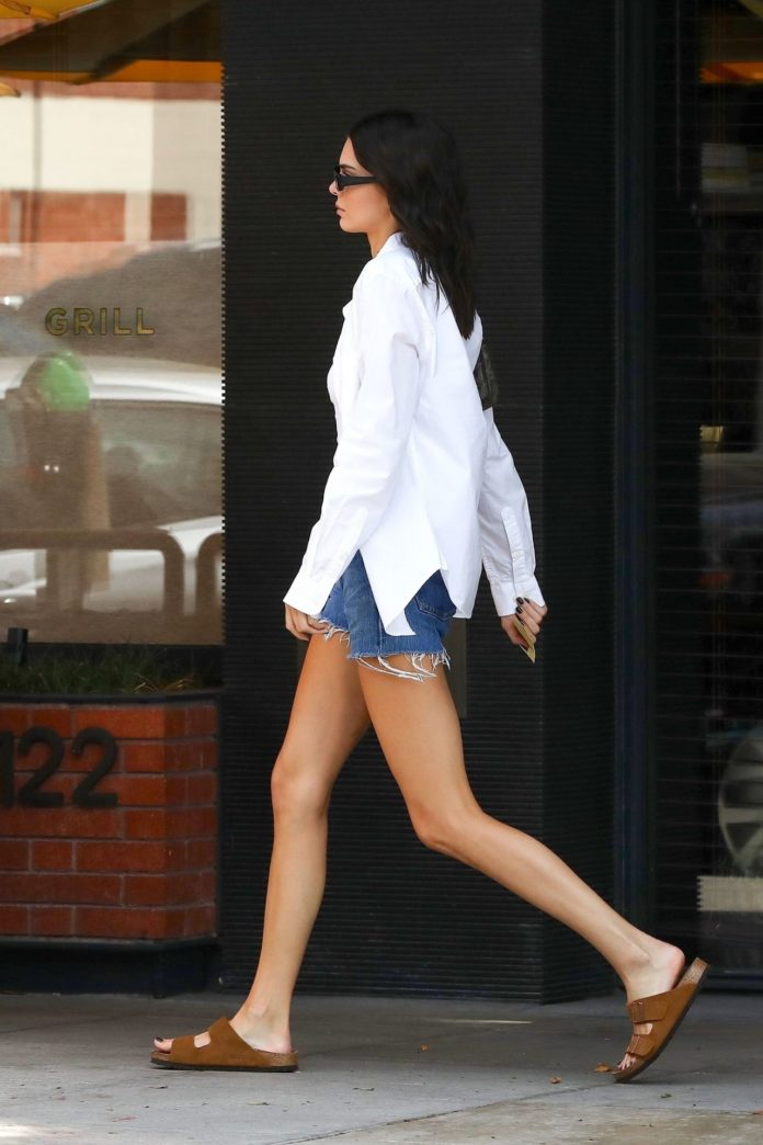 Kendall Jenner in Denim Shorts and Oversized Button-Up Shirt