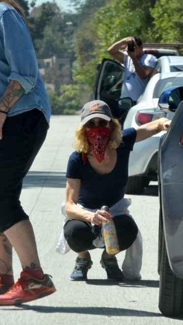 Kyra Sedgwick Goes For a Walk With Mask