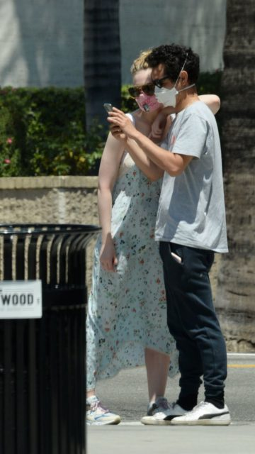 Elle Fanning In A Long Sleeveless Floral Print Dressout At LA